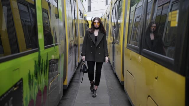 Maxilie Mlinarskij wearing Dolce Gabbana bag Chloe boots black cropped Dr Denim jeans green HM wool coat Zero Vintage sunglasses black HM top choker...
