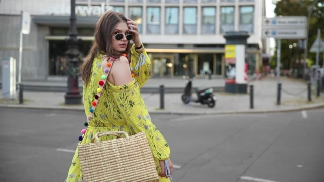 maxilie mlinarskij wearing yellow maxi dress self portrait nannacay bag nike m2k tekno sneakers ray ban sunglasses on august 5 2018 in berlin germany - yellow stock videos & royalty-free footage