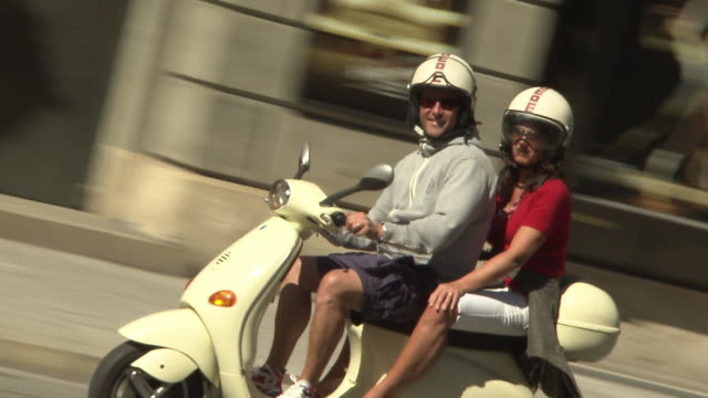 maximilianstraãŸe, street, two people drive with scooter - motorroller stock-videos und b-roll-filmmaterial