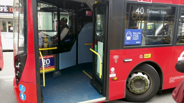 maximum capacity and face mask signs on a bus in east dulwich on june 15th, 2020 in london, england. the british government have relaxed coronavirus... - bus stock videos & royalty-free footage