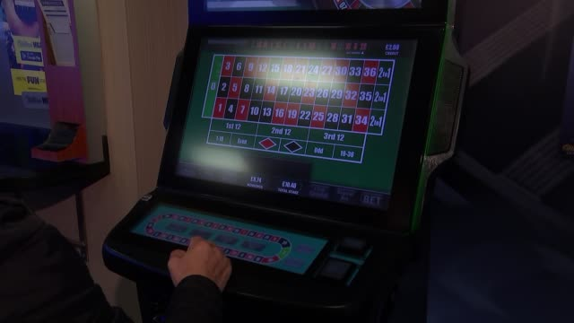 maximum stakes on fixedodds gambling machines to be cut to £2 england int anonymous shots of person playing fixed odds betting terminal / close shot... - 安定点の映像素材/bロール