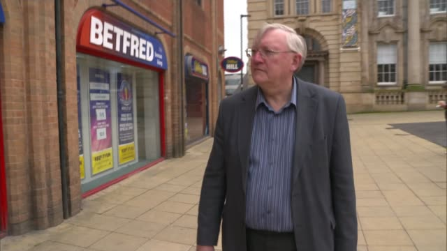 maximum stakes on fixedodds gambling machines to be cut to £2 england south yorkshire sheffield coral and betfred bookmakers alongside each other on... - sheffield stock videos and b-roll footage