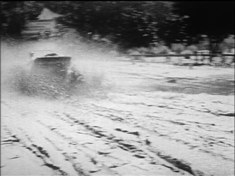 b/w 1918 rear view maxwell car driving thru mud puddle / california / industrial - 1918 stock videos and b-roll footage