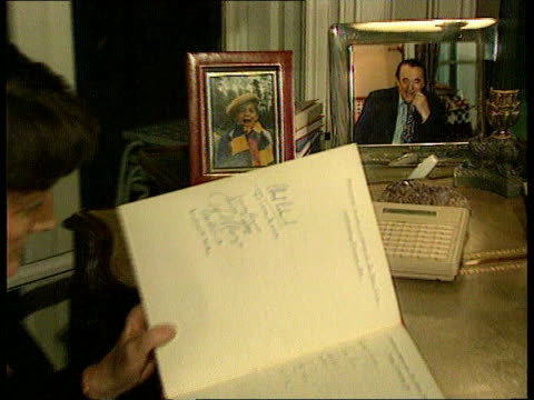 maxwell pension fund cms robert maxwell photograph in frame pull out wife elizabeth sitting looking through diary lms more ditto zoom in - robert maxwell stock videos and b-roll footage