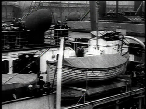 stockvideo's en b-roll-footage met may 1 1915 pan passengers aboard the docked rms lusitania / new york new york united states - 1915