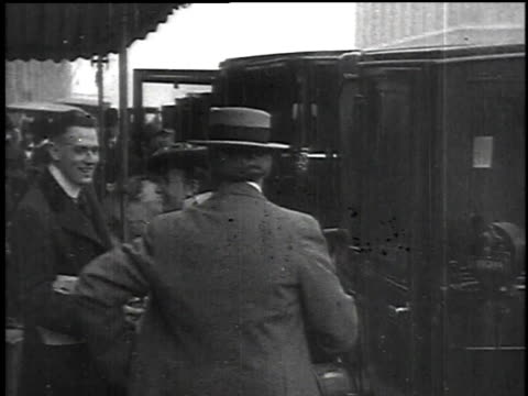 stockvideo's en b-roll-footage met may 1 1915 pan people getting out of taxis at a dock / new york new york united states - 1915