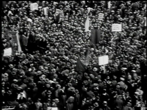 may 1, 1930 b/w montage may day parade, soapbox orators yelling to crowd, throng of spectators, sea of men all wearing hats, union square / new york... - 1930 stock videos & royalty-free footage