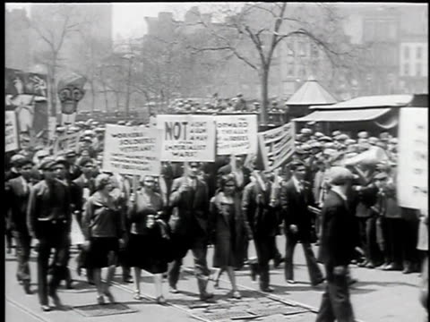 vídeos y material grabado en eventos de stock de may 1, 1930 b/w montage may day parade, young women, men and children marching, one holding poster 'not a cent a gun a man for imperialist wars!',... - 1930