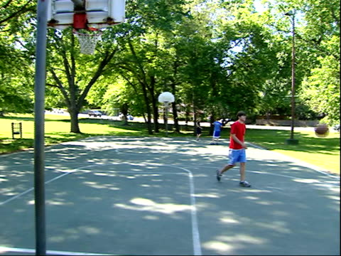 may 1 2006 ts teenage boy playing basketball at park / united states - shooting baskets stock videos and b-roll footage