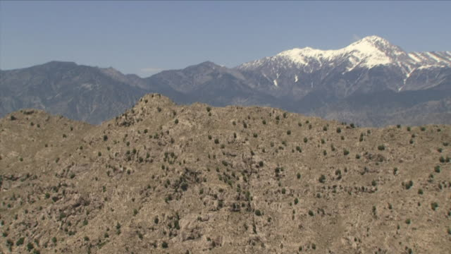 May 1 2009 AERIAL MS Hill and snowcapped mountain / Najil Afghanistan