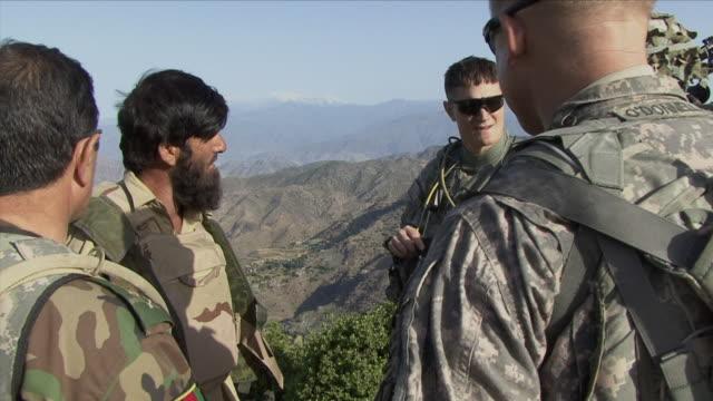 May 1 2009 MS American and Afghan soldiers talking on top of mountain / Konar Valley Afghanistan / AUDIO