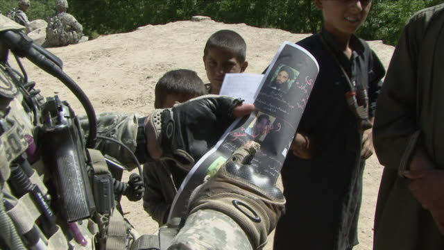 may 1 2009 cu tu td american soldier explaining photographs to local children / najil afghanistan / audio - brochure stock videos & royalty-free footage