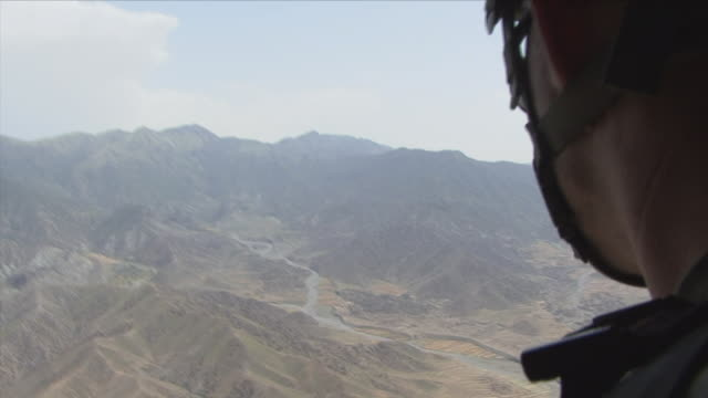 May 1 2009 CU American soldier observing terrain from helicopter / Konar Valley Afghanistan