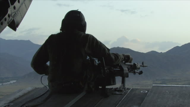 May 1 2009 WS American soldier patrolling terrain from helicopter / Konar Valley Afghanistan