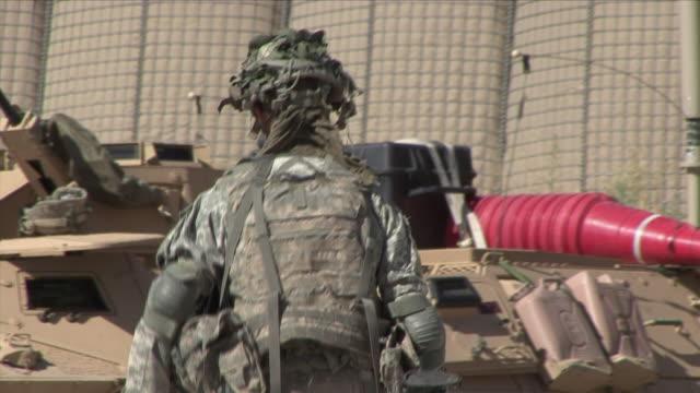 May 1 2009 MS TU American soldier walking toward armored vehicles / Konar Valley Afghanistan