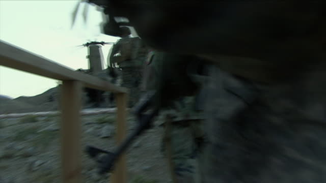 may 1 2009 ms pov american soldiers boarding helicopter / konar valley afghanistan - kunar province stock videos & royalty-free footage
