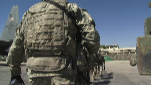 May 1 2009 MS POV American soldiers boarding plane / Konar Valley Afghanistan