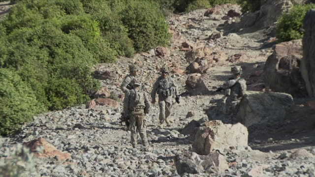 May 1 2009 LS WS ZO American soldiers climbing up mountain / Konar Valley Afghanistan