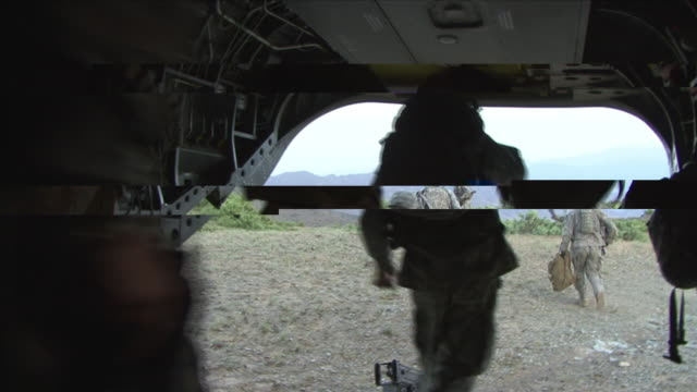 May 1 2009 WS POV American soldiers disembarking helicopter and taking positions / Konar Valley Afghanistan