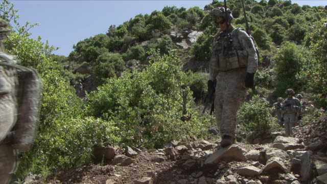 May 1 2009 WS American soldiers going down mountain / Konar Valley Afghanistan