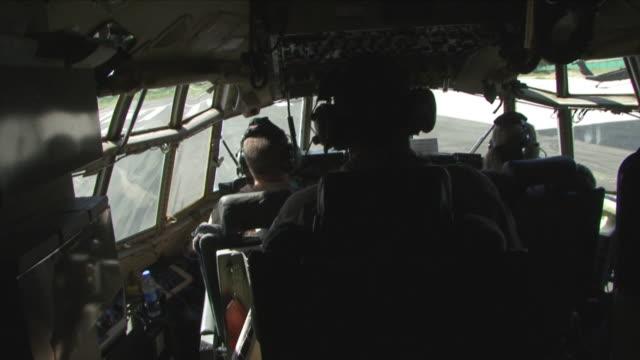 May 1 2009 MS American soldiers inside airplane taxiing / Konar Valley Afghanistan