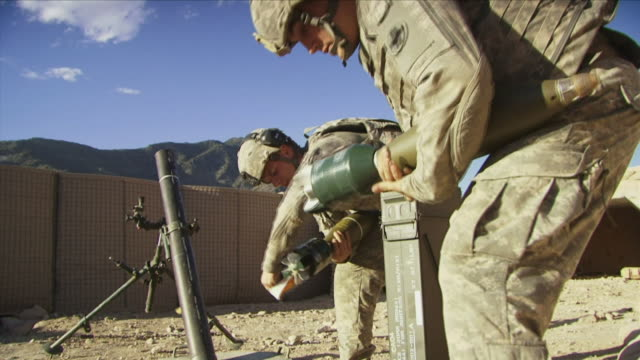 may 1 2009 ms la american soldiers unpacking bombs / najil afghanistan / audio - 迫撃砲点の映像素材/bロール