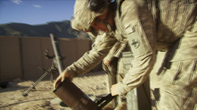 may 1 2009 ms american soldiers unpacking new bombs in base / najil afghanistan / audio - 迫撃砲点の映像素材/bロール