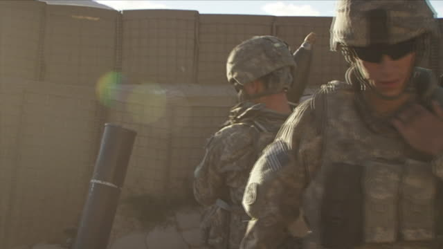 may 1, 2009 american soldiers using mortar to launch bombs / najil, afghanistan / audio - operation enduring freedom stock videos & royalty-free footage