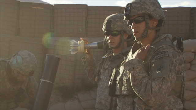 may 1 2009 ms american soldiers using mortar to launch bombs / najil afghanistan / audio - 迫撃砲点の映像素材/bロール