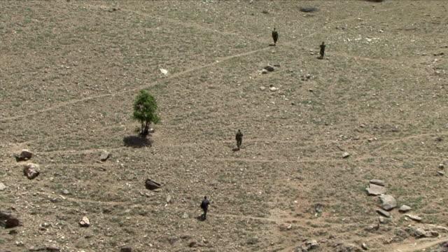 May 1 2009 WS HA American soldiers walking across plain / Najil Afghanistan