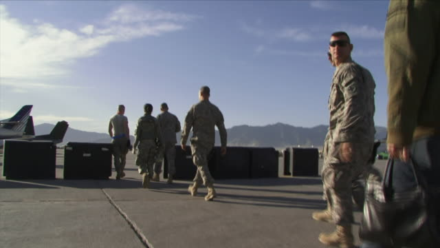 may 1, 2009 american soldiers walking toward airplane / bagram, afghanistan - bagram stock videos & royalty-free footage