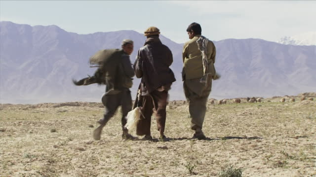 may 1, 2009 farmers walking across field / bagram, afghanistan - bagram stock videos & royalty-free footage