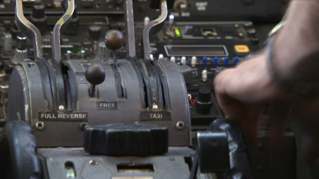 may 1, 2009 hand gripping levers in cockpit of military airplane / najil, afghanistan - throttle stock videos & royalty-free footage