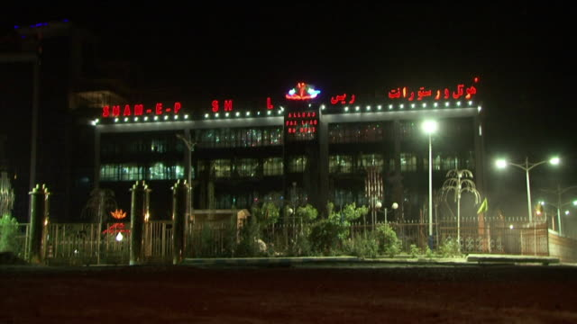 may 1 2009 ws hotel neons glowing at night / kabul afghanistan - kabul stock-videos und b-roll-filmmaterial
