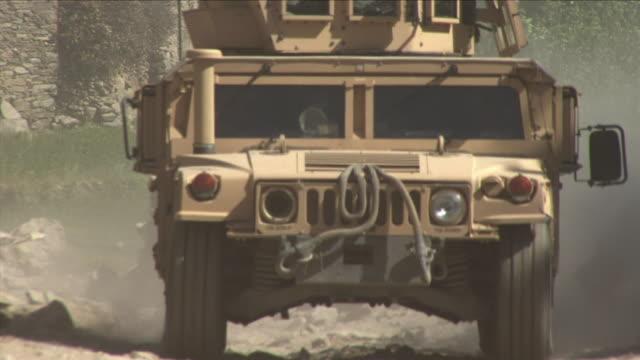 may 1 2009 cu zo ws humvee driving on dirt road / najil afghanistan - humvee stock videos & royalty-free footage