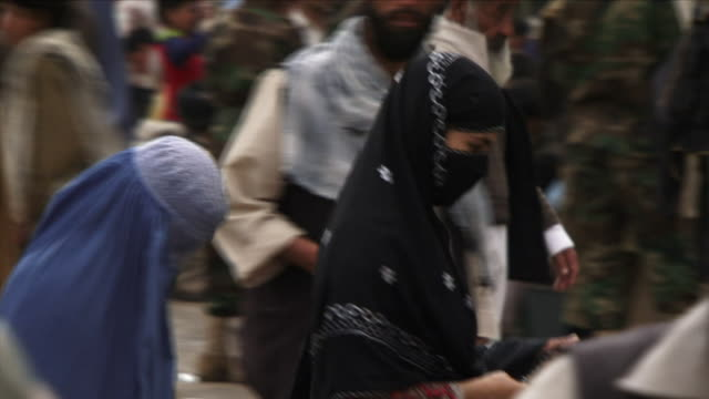 may 1 2009 cu pan selective focus crowded street with women wearing burkas prominent / kabul afghanistan - afghanistan stock videos & royalty-free footage