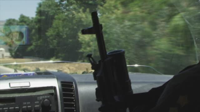May 1 2009 CU Silhouette of gun transported in car / Konar Valley Afghanistan