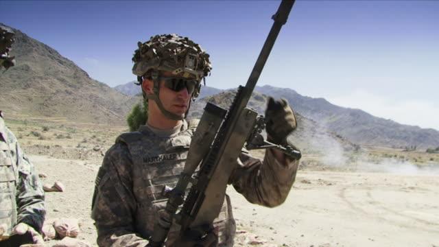 May 1 2009 MS Sniper demonstrating gun / Konar Valley Afghanistan