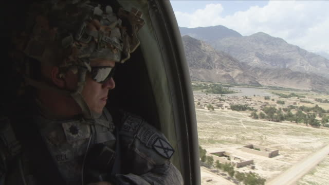may 1 2009 ms soldier observing terrain from helicopter / konar valley afghanistan - kunar province stock videos & royalty-free footage