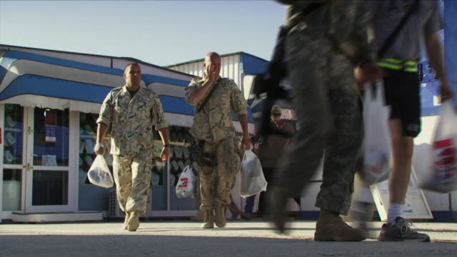 May 1 2009 WS Soldiers carrying shopping at US military base / Bagram Afghanistan