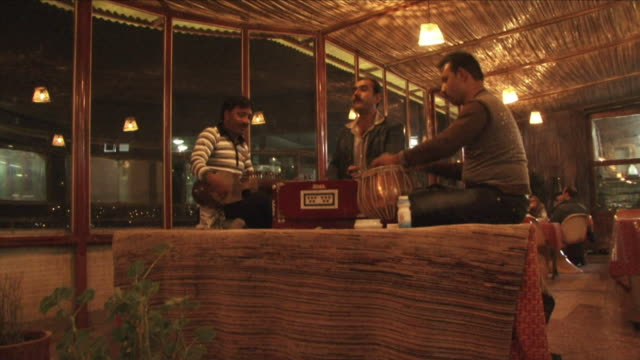 may 1 2009 ws three musicians playing in restaurant / kabul afghanistan / audio - kabul stock-videos und b-roll-filmmaterial