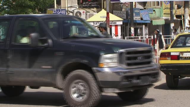 may 1 2009 ws traffic cop directing traffic in street / kabul afghanistan - kabul stock-videos und b-roll-filmmaterial