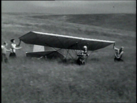 may 11, 1936 montage test pilot attempting to take off in a hang glider by running / palos verde, california, united states - failure stock videos & royalty-free footage