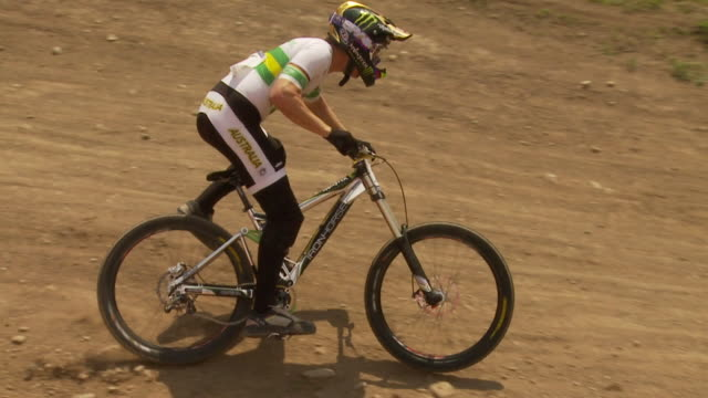 may 11 2009 ts a professional downhill mountain bike racer crashing through a corner recovering and continuing on with the race - mountain bike stock videos & royalty-free footage