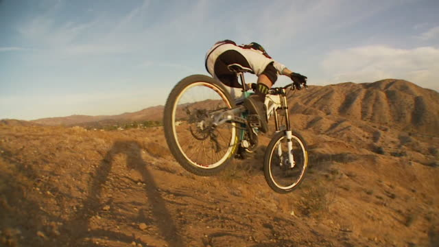 may 11 2009 montage professional downhill mountain bike racer making a fast paced run with freestyle jumps - mountain bike video stock e b–roll