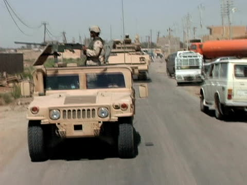 May 13 2004 WS PAN REAR POV Soldiers patrolling streets Baghdad Iraq AUDIO