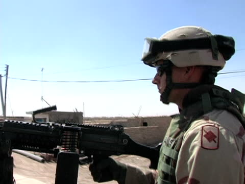 May 13 2004 WS PAN POV Soldiers patrolling streets Baghdad Iraq AUDIO