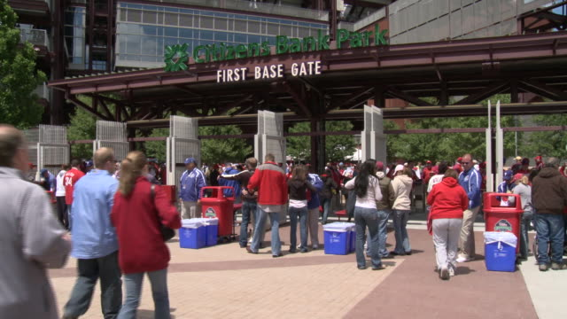may 13 2010 ws baseball fans entering first base gate at phillies' citizens bank park / philadelphia pennsylvania united states - philadelphia phillies stock-videos und b-roll-filmmaterial