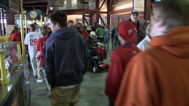 may 13 2010 ws baseball fans walking through concessions area at phillies' citizens bank park / philadelphia pennsylvania united states - philadelphia phillies stock-videos und b-roll-filmmaterial