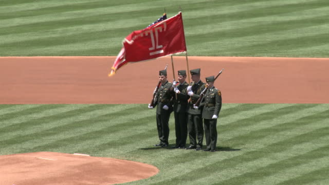 vídeos de stock e filmes b-roll de may 13 2010 ws color guard with flags standing in infield before baseball game at citizens bank park / philadelphia pennsylvania united states - citizens bank park